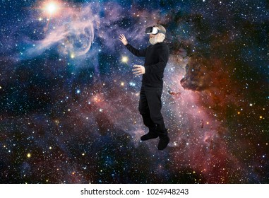 Man with VR Virtual Reality googles experiencing the wonders of space looking at a star.