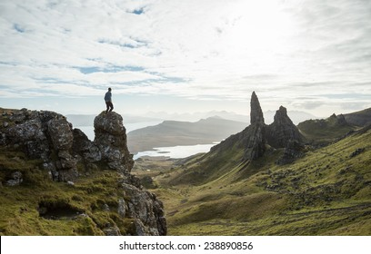 Man vs Nature, overlooking a stunning view of old rock pinnacle from a cliff top in the Isle of Skye, Scotland. Old Man of Storr.