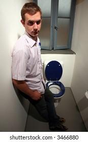 man wait in the toilette