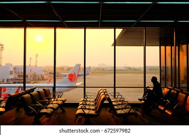 A man waited for the time went to the plane at Don Muang airport, Bangkok , February 2016