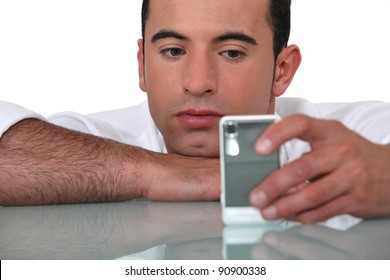man waiting for a call on his cell