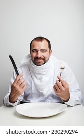 Man waiting for the lunch with fork and knife