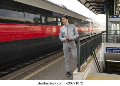 Man waiting for train at train station.