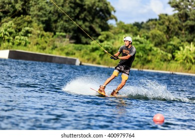 Man Wakeboarding in action. Phuket, Thailand. shifted horizon