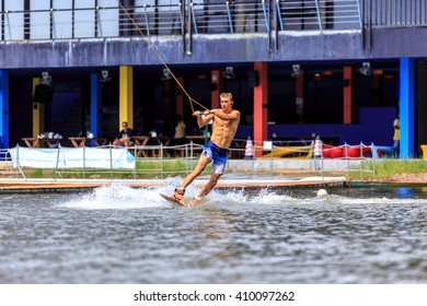 Man Wakeboarding in action. Phuket, Thailand