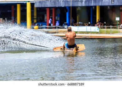 Man Wakeboarding in action. Phuket, Thailand