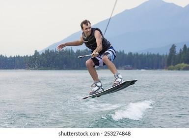Man wakeboarding on a beautiful mountain lake