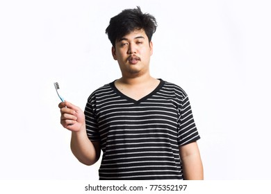Man wakes up and brushes his teeth.