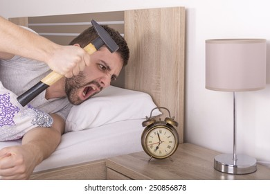 Man wakes up and he is mad at clock ringing