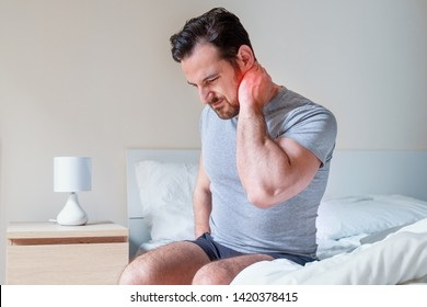 Man waking up in the morning and suffer for stiff neck