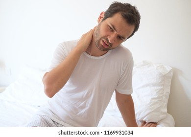 Man waking up in the morning and suffering because of backache