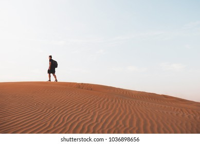 Man walk on a desert sand dunes, lost in a desert, Dubai