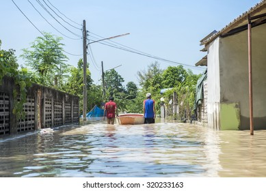 Man walk on a flooded section of road