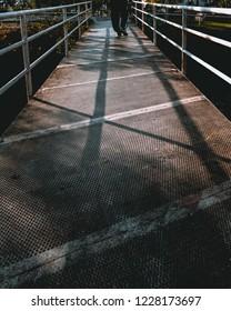 Man walkin on the bridge