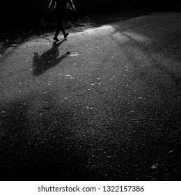 man walkin shadow