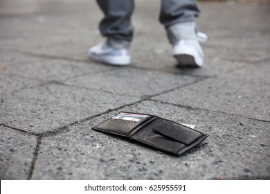 Man Walking After Losing His Wallet On Street