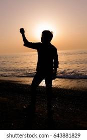 Man walking alone Backlit, Sunset