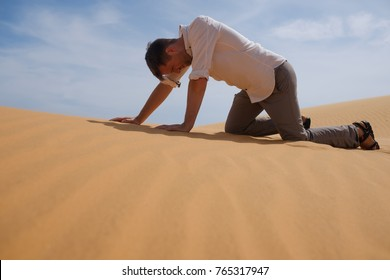 Man walking alone in the sunny desert. He is lost and out of breath. No water and energy. Concept for depression and noway situation in life