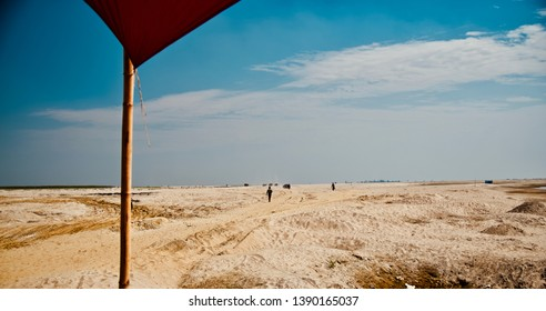 Man walking around a sandy surface isolated unique photo