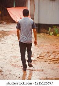 Man walking around a wet muddy road unique photo