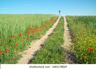 Man walking away and jump on pathway at green spring meadow. - Shutterstock ID 1681178029