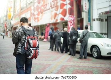 man walking with backpack and blur people were queuing for eating in food shop
