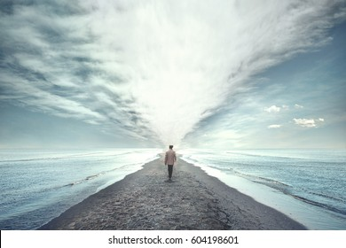 man walking between two seas
