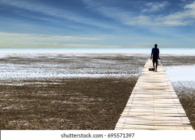 Man walking at boardwalk to sea,Thailand.