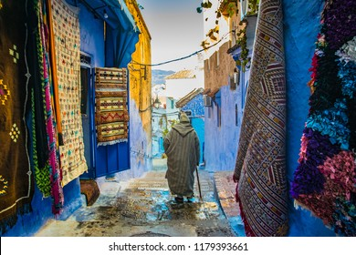 man walking in Chefchaouen street, Morocco