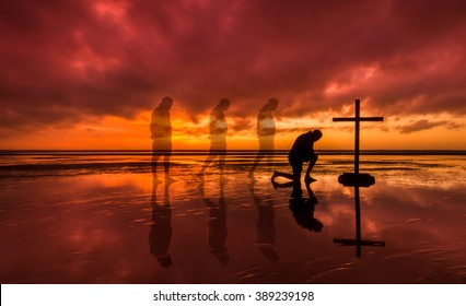 Man walking to a cross and kneeling before it.