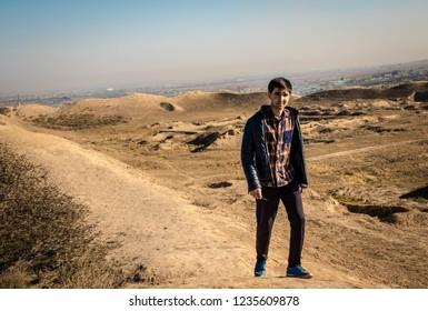 a man walking in the desert towards the ancient Parthian (Iranian) capital Nisa