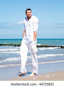 Man walking down the coast relaxing and enjoying freedom