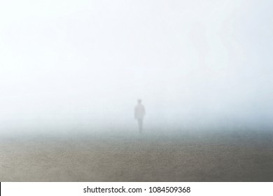 man walking in the fog