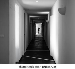 a man walking in the hallway.