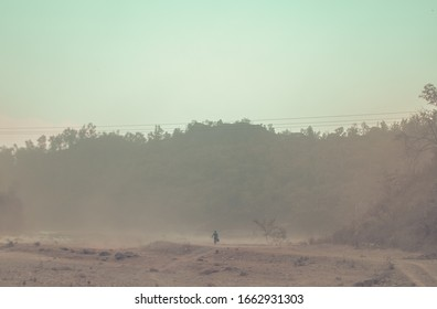 Man walking home in a dust storm