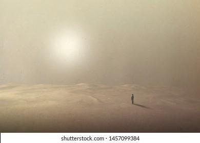 man walking in the hot desert under the shining sun