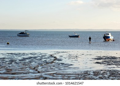 A man walking into the river at low tide, Southend-on-sea