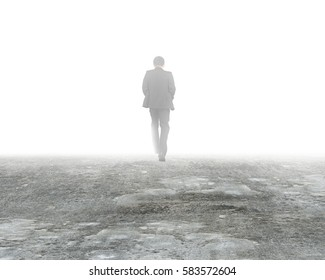 Man walking in mystery fog on dirty concrete floor