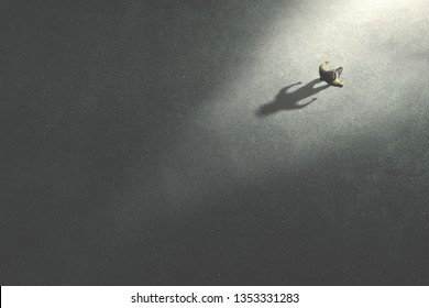 man walking in the night toward the light