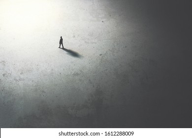 man walking in the night toward the light