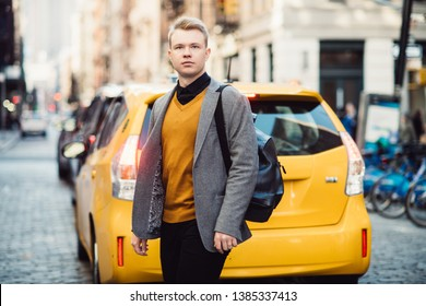 Man walking on city street from the taxi wearing casual outfit with kacjet and backpack in New York City
