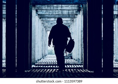 Man walking on the concrete surface of a construction building isolated unique photo