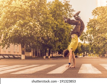 Man walking on hands upside down