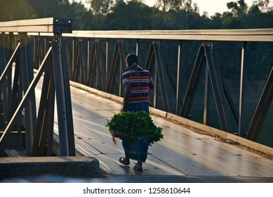 Man walking on a metallic bridge way isolated unique photo