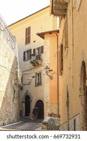 Man walking on a narrow street of Arpino village