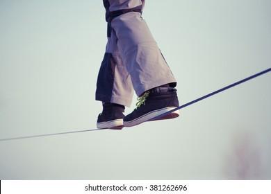 Man walking on slackline
