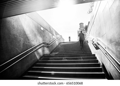 man walking up on the stairs from metro station