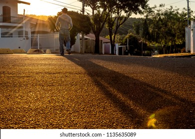 Man walking on the street against the sunlight