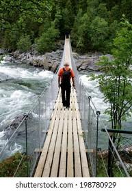 Man walking on a suspension bridge