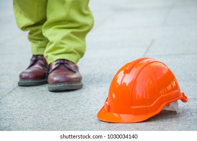A man walking in to orange hat. Engineer man walking for work.He move left foot.It is symbol for good work.Photo engineer and work.